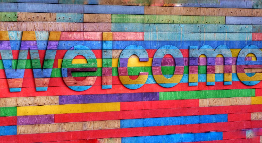 Colorfully painte sign that says welcome depicting Diag Partners welcoming Samantha Ziarko as managing partner